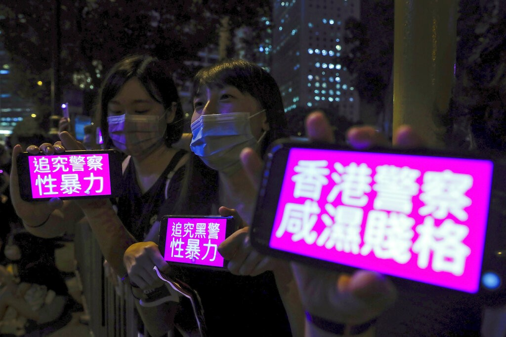 """Chinese characters read """"accusing police's sexual violence"""" and """"Hong Kong police, perverted and low-classed"""""""