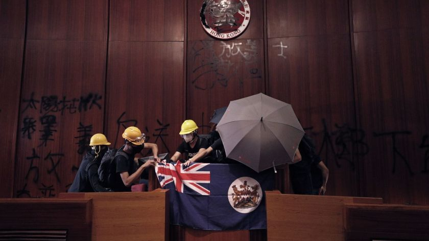 File photo: Protesters storm the Legislative Council Building in Hong Kong, display colonial flag, July 1
