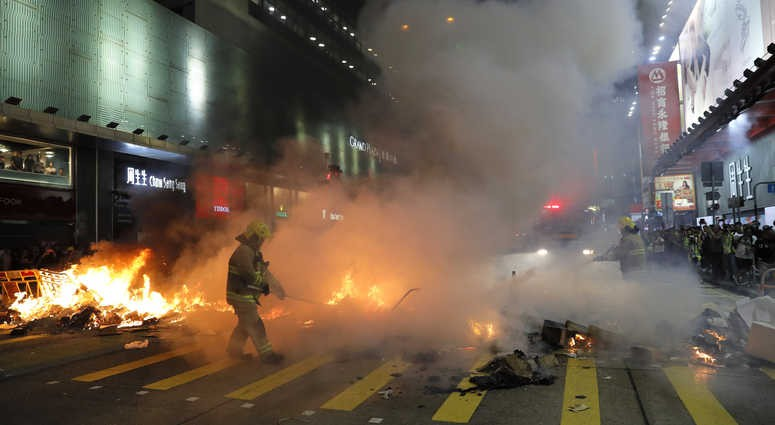 Fires set by protesters outside Mong Kok MTR Station extinguished by firefighters, Sept. 6