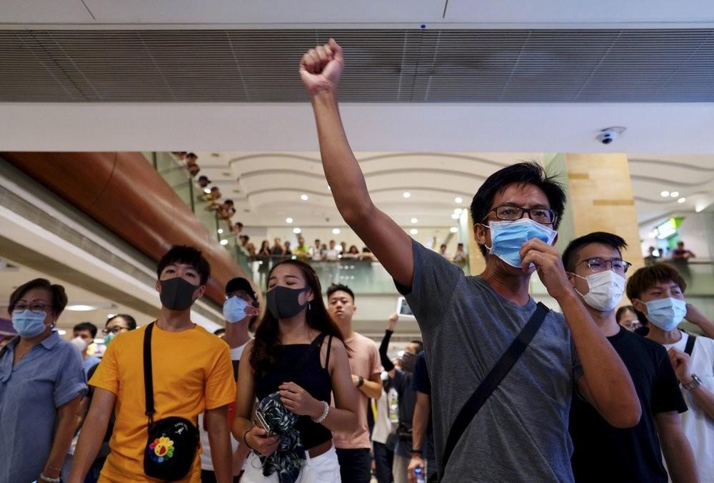 Protesters shout slogans at a shopping mall in Hong Kong, Saturday, Sept. 7