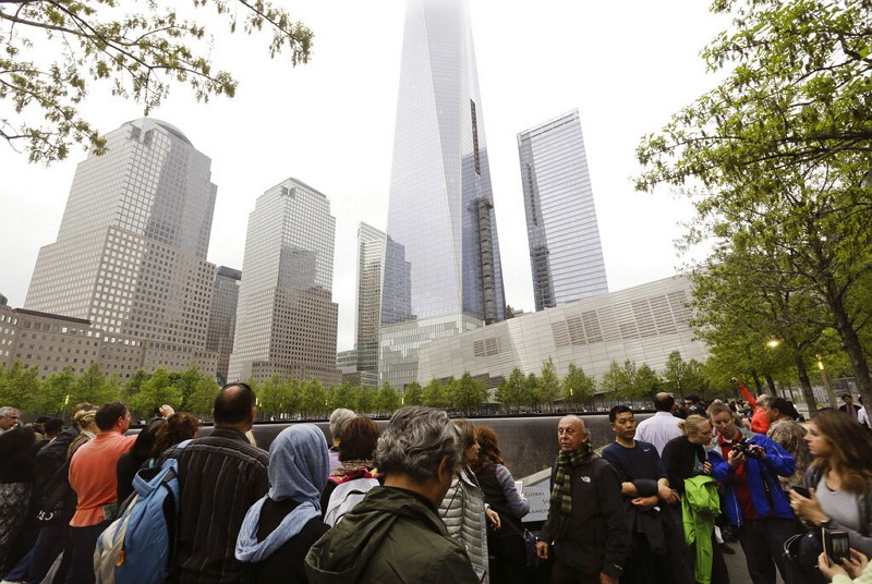 In this May 15, 2015 file photo, visitors gather near the pools at the 9/11 Memorial in New York. (AP photo)