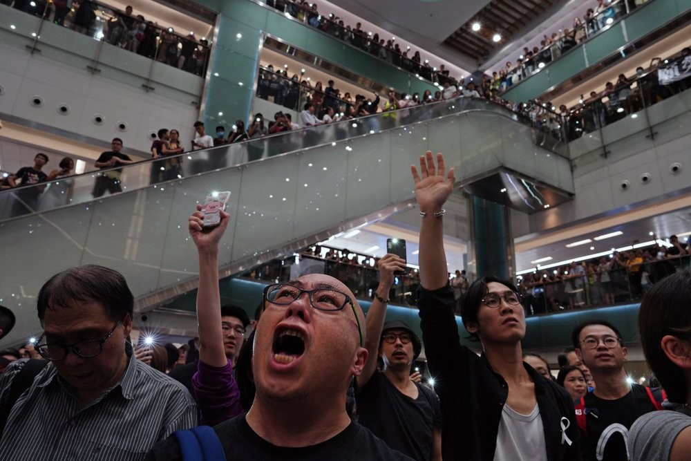 Protesters singing 'Glory to Hong Kong' at a shopping mall.