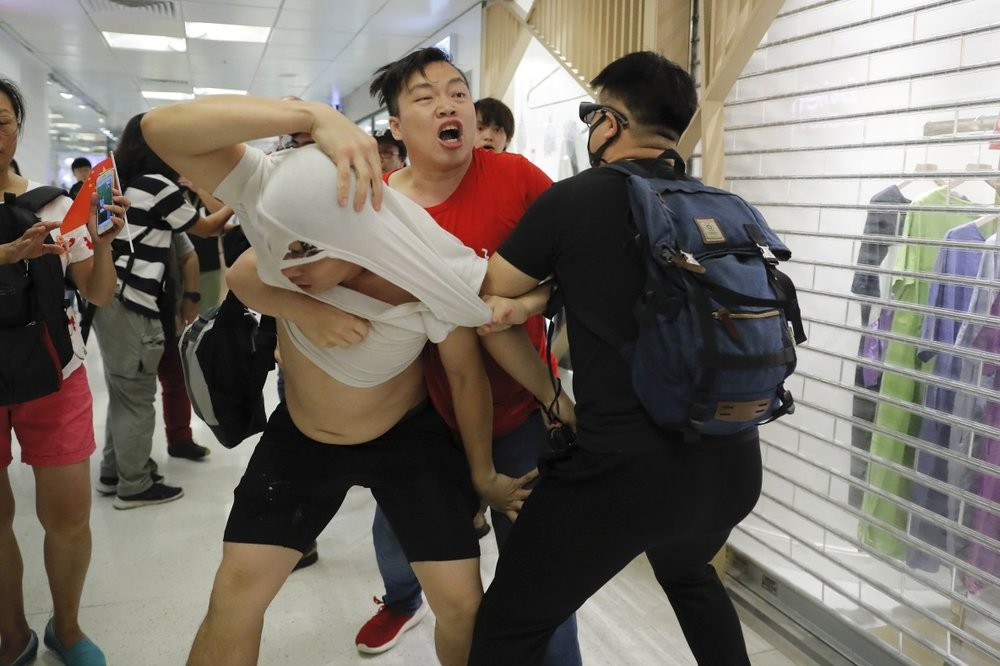 Fights between pro- and anti-China protesters in Hong Kong.