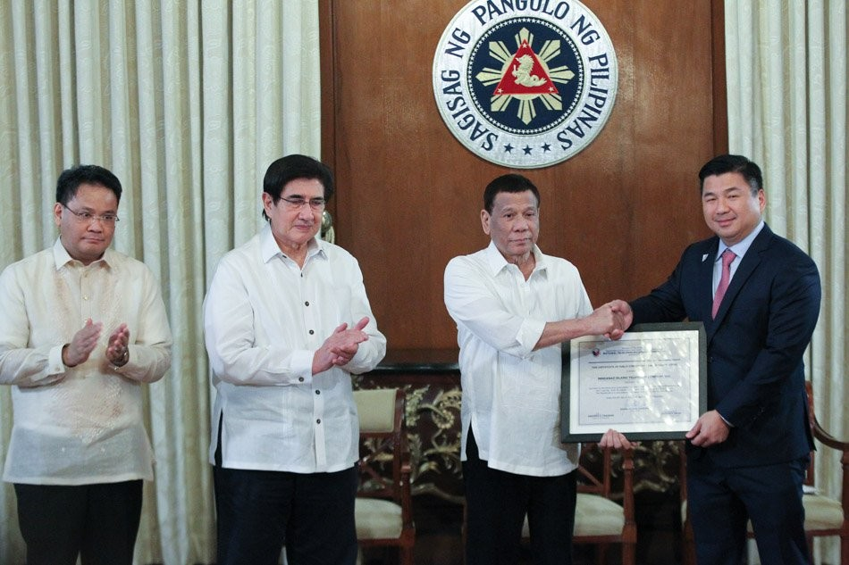 File Photo: Duterte awards Chairman Dennis Uy certificate of Public Convenience and Necessity for Dito Telecom (formerly Mislatel) on July 8 (Presiden...