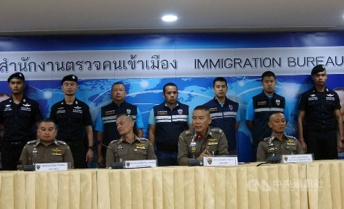 Thai police presenting a case against Taiwanese suspects last August.
