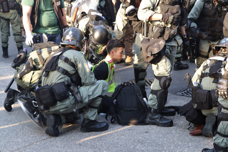 Protester arrested in Hong Kong, Saturday, Sept. 21