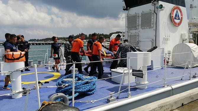 Dragon boat team member rescued from waters off of Boracay, Sept. 25 (Philippine Coast Guard photo)