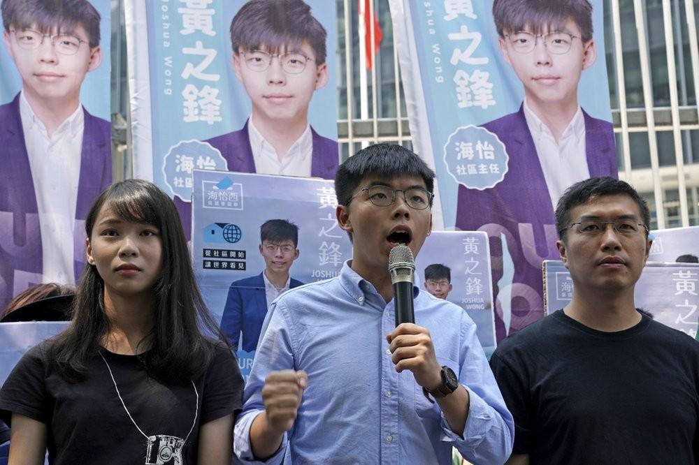 Joshua Wong (center) announcing his election bid in Hong Kong Saturday (September 28).