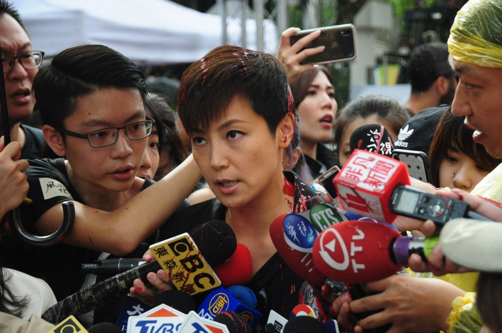 Denise Ho speaks to reporters after being doused in red paint, Sept. 29