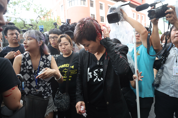 Hong Kong activist Denise Ho doused in paint by masked man in Taipei