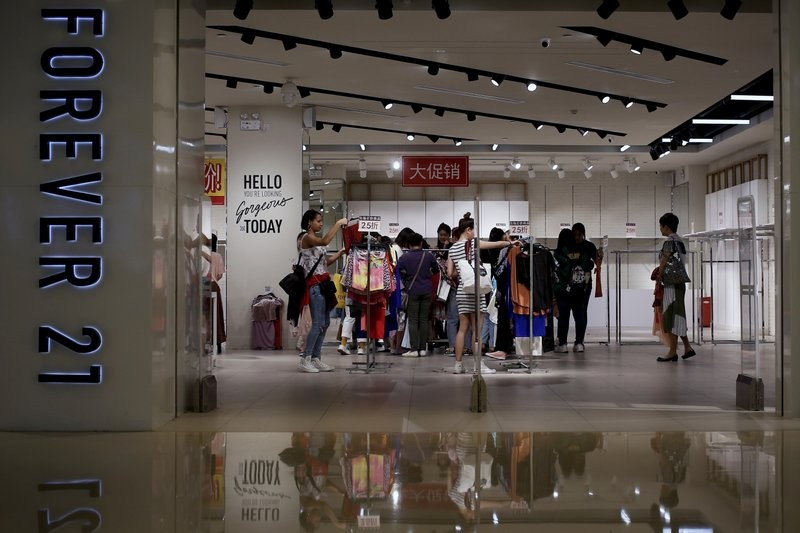 File photo: shoppers at Forever 21 in May, 2019