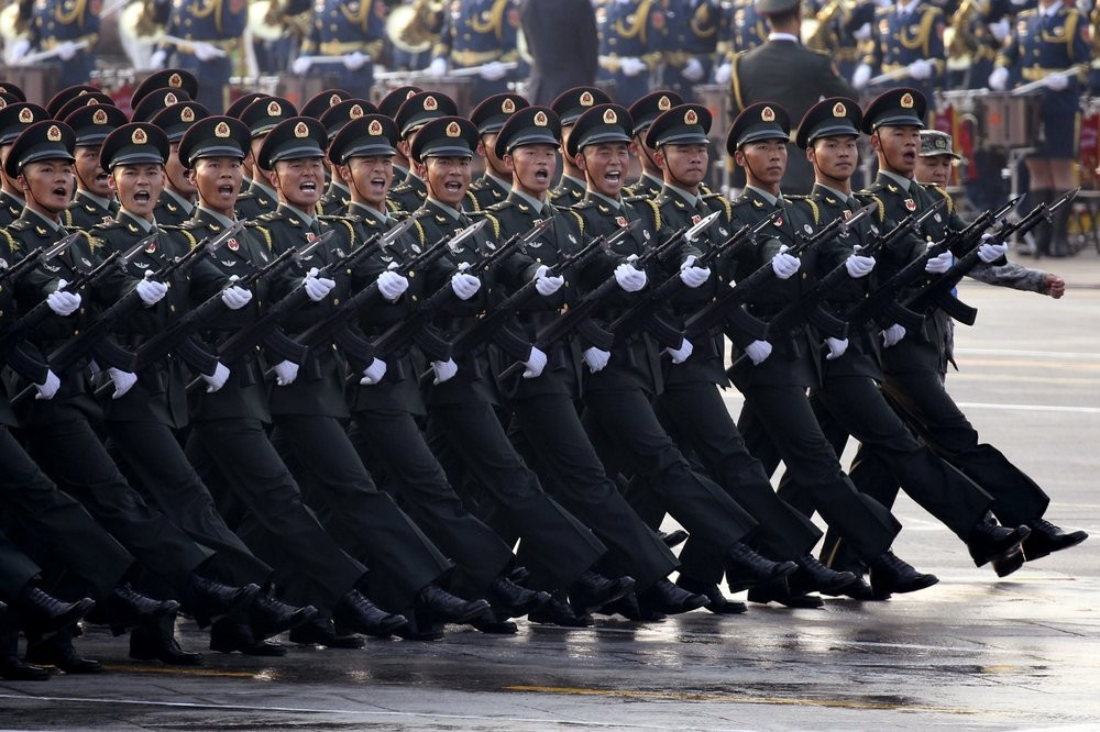 PLA troops march in Beijing on Oct. 1