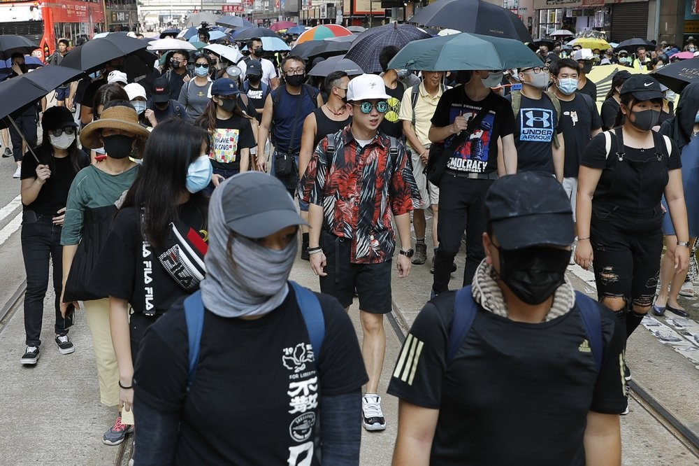 Protesters defy a ban on masks in Hong Kong Saturday October 5.