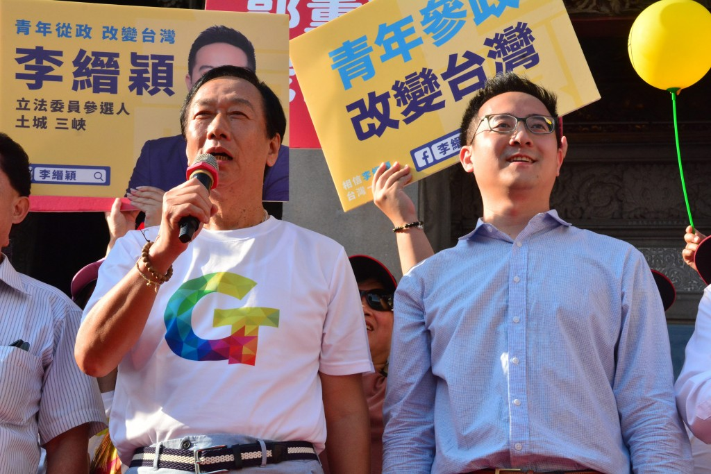 Foxconn founder Terry Gou (left) with legislative candidate Lee Chin-ying.