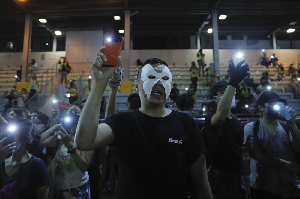 Masked Hong Kongers sing protest anthem, Oct. 5