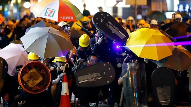 File photo: Hong Kong protesters with laser pointer