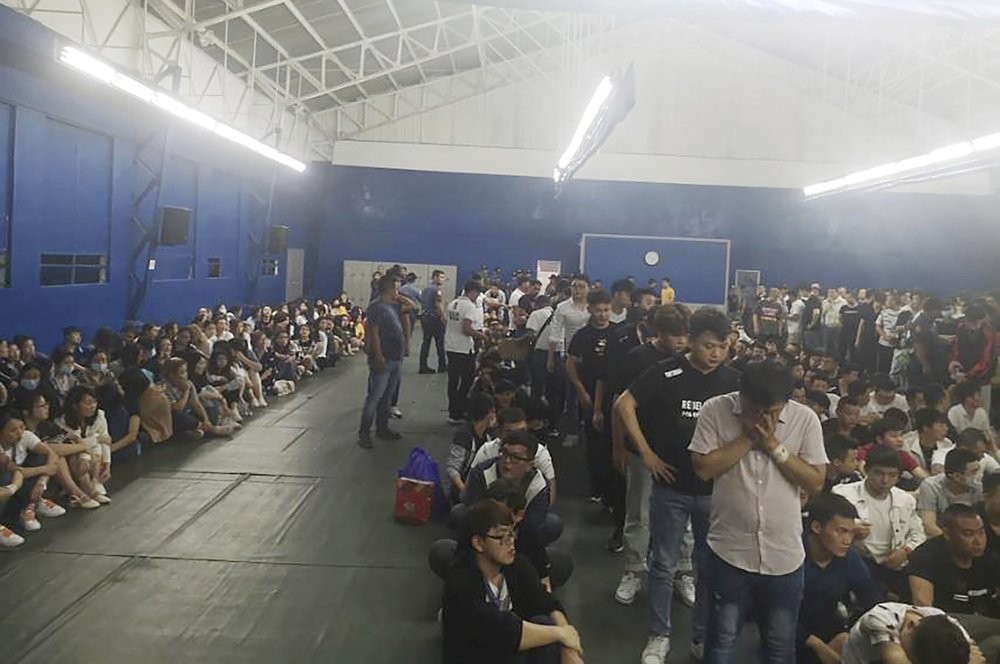 Suspects being held in a gymnasium