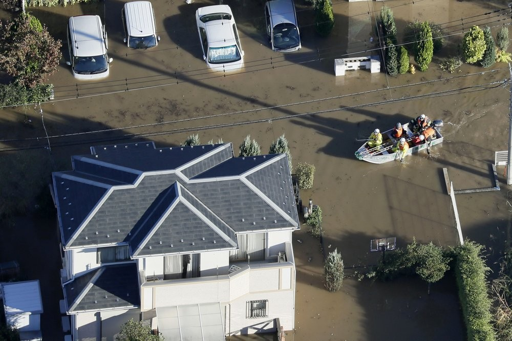 Rescuers in Sakado, on the outskirts of Tokyo, Sunday, Oct. 13