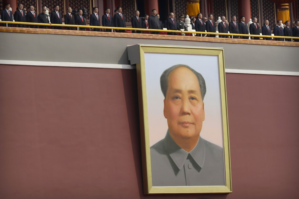 Portrait of Mao in Tiananmen Square with Xi Jinping standing above. Oct. 1, 2019