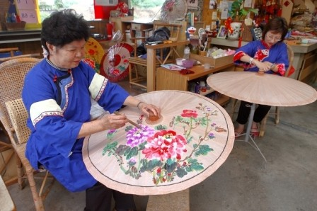 Craftspeople painstakingly create ornate umbrellas to catch the eye of tourists from the four corners of the globe.