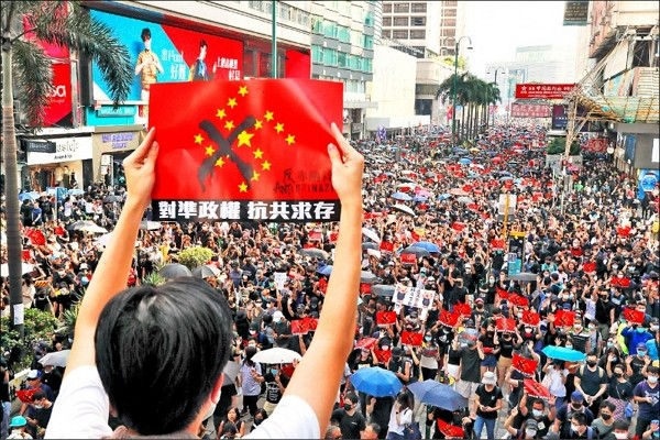 Hongkongers gather at Tsim Sha Tsui Sunday.