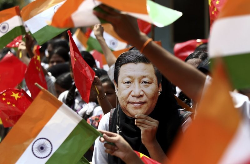 Indian student wears mask of Chinese leader Xi Jinping in Chennai, India, Oct. 10 (AP photo)