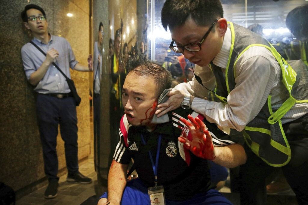 Defiant Hong Kong protesters mark one-month ban on masks