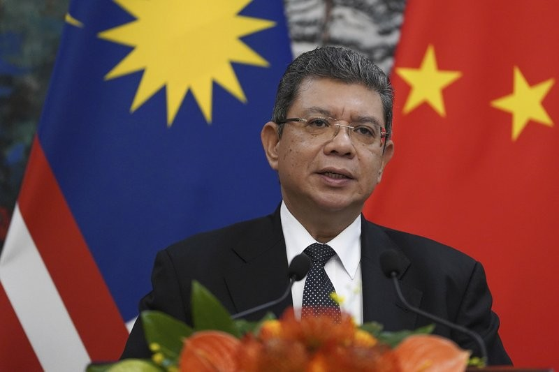 Malaysian Foreign Minister Saifuddin Abdullah speaks during a press conference at the end of a meeting with Chinese Foreign Minister Wang Yi at the Di...