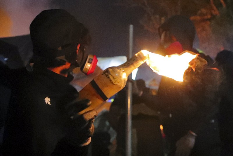 A student holds a molotov cocktail during clashes at the Chinese University in Hong Kong on Nov. 12.