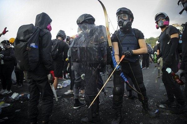 Students wield bows and shields outside City University of Hong Kong.