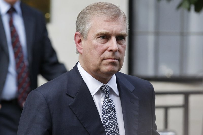 In this June 6, 2012 file photo, Britain's Prince Andrew leaves King Edward VII hospital in London after visiting his father Prince Philip. (AP photo)