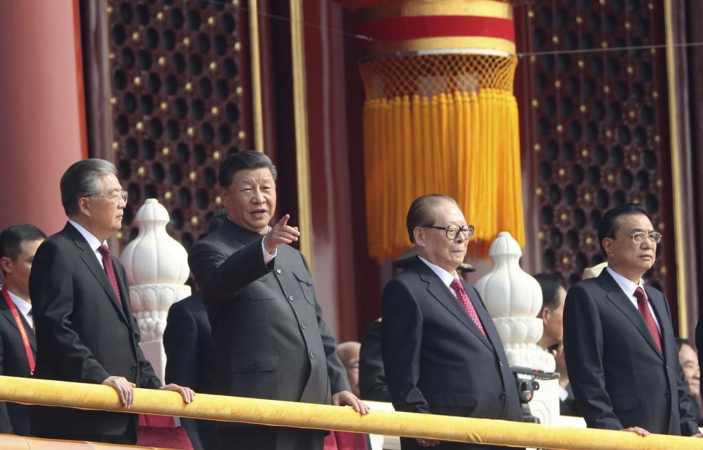 Chinese President Xi Jinping (center left), former presidents Jiang Zemin (center right), Hu Jintao (left), and Premier Li Keqiang (right).