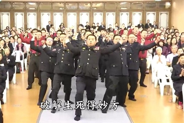 Law enforcement officers dance in religious video. (Youtube screenshot)