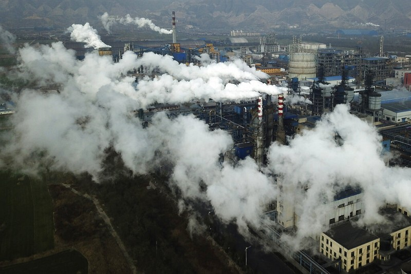 Smoke and steam rise from a coal processing plant in Shanxi.