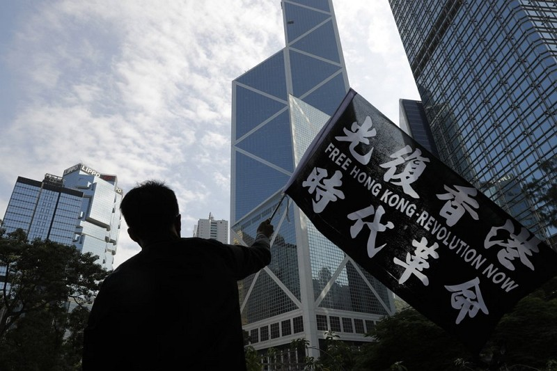 A pro-democracy supporter waves a flag during a rally in Hong Kong.