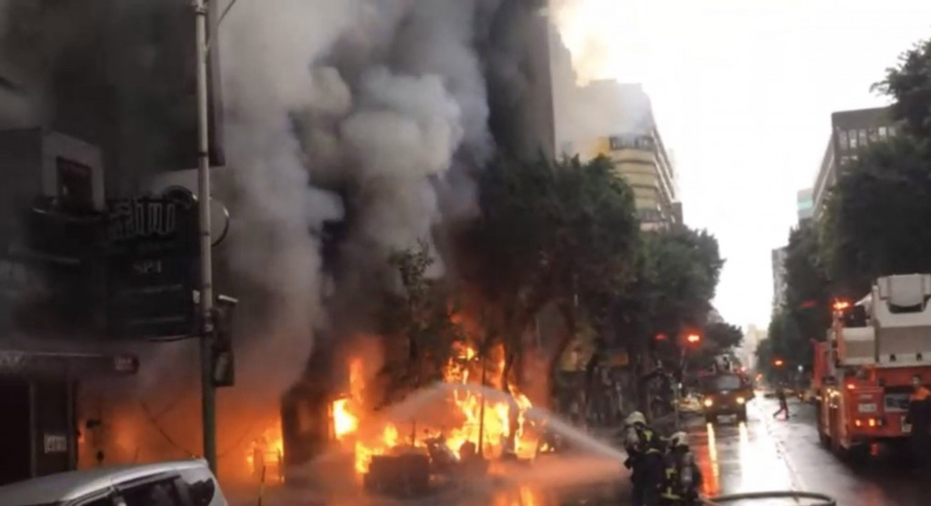 Fire erupted near a four-faced Buddha in Taipei Saturday morning.
