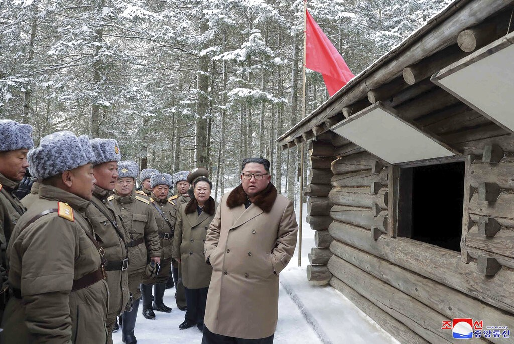 This undated photo provided on Wednesday, Dec. 4, 2019, by the North Korean government shows North Korean leader Kim Jong Un, right, speaks to lieuten...