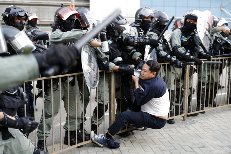 Riot police detain a protester in Hong Kong.
