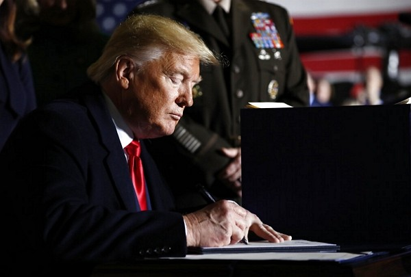 President Trump signs NDAA into law Dec. 20.