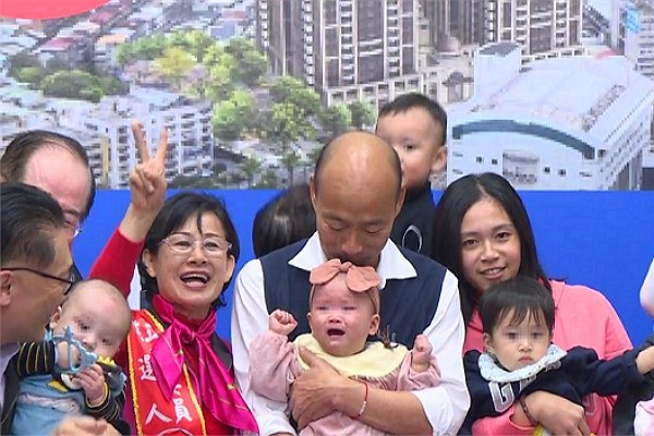 Taiwan presidential candidate criticized for kissing infant without mother's permission