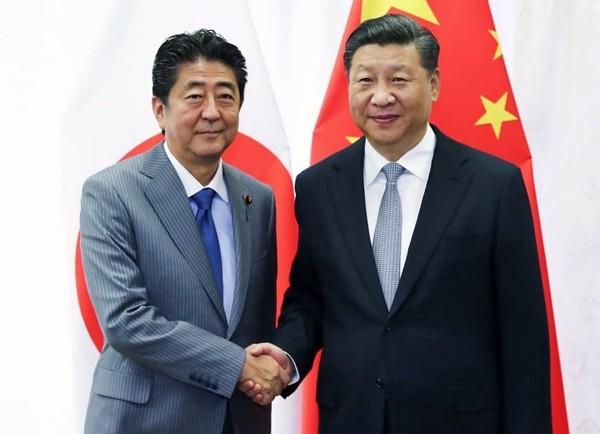 Shinzo Abe and Xi Jinping meet in Beijing Dec. 23.