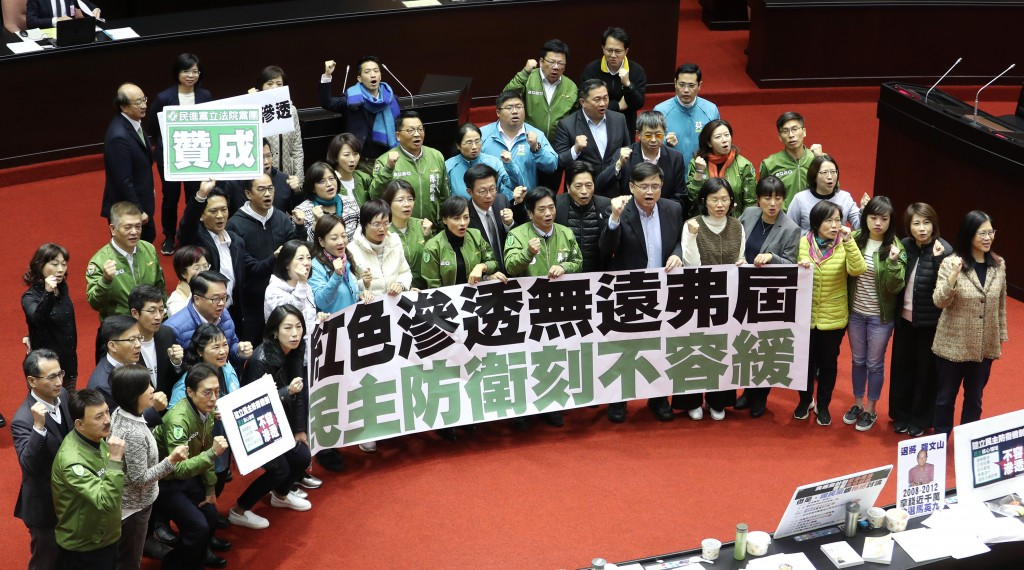 DPP lawmakers celebrating the passage of the Anti-Infiltration Act Tuesday (Dec. 31).