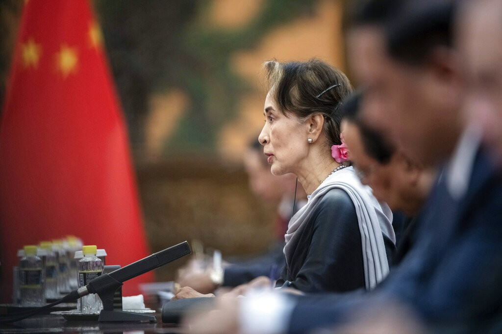 Myanmar State Counsellor Aung San Suu Kyi listens to Chinese President Xi Jinping during a meeting at the Great Hall of the People in Beijing, Wednesd...