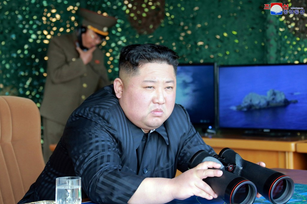 Photo from North Korean govt. shows leader Kim Jong Un with binoculars observing missile tests
