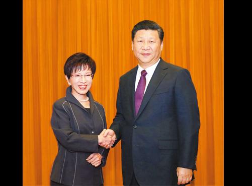 File photo: Hung Hsiu-chu and Xi Jinping (2016, China govt. handout)