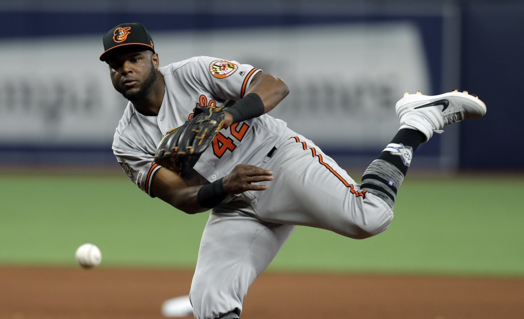 Baltimore Orioles second baseman Hanser Alberto can't get Tampa Bay Rays' Kevin Kiermaier at first on an infield single during the seventh inning of a