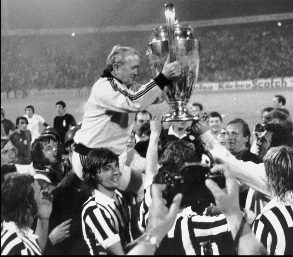 FILE - In this May 30, 1973 file photo, Ajax coach Stefan Kovacs raises the Champions Cup, carried in triumph by his players, after Ajax beat Juventus