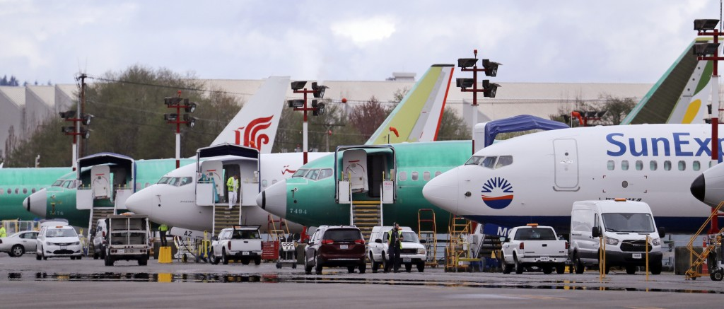 FILE - In this April 8, 2019, file photo, Boeing 737 Max model aircraft are parked at the airport adjacent to a Boeing Co. production facility in Rent