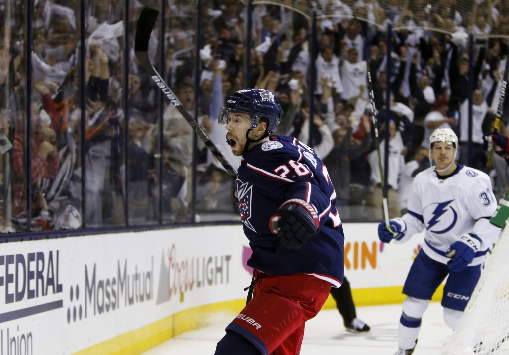 Columbus Blue Jackets' Oliver Bjorkstrand, of Denmark, celebrates his goal against the Tampa Bay Lightning during the second period of Game 4 of an NH...