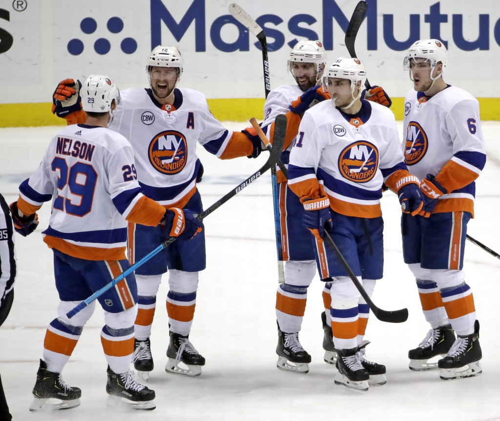 New York Islanders' Josh Bailey (12) celebrates his empty-net goal against the Pittsburgh Penguins during the third period in Game 4 of an NHL hockey ...